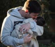 Lionel Messi kissing his son