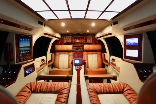 Lexani Motorcars' GMC Yukon XL Conversion Coach makes it easy to forget you're not in a Private Jet