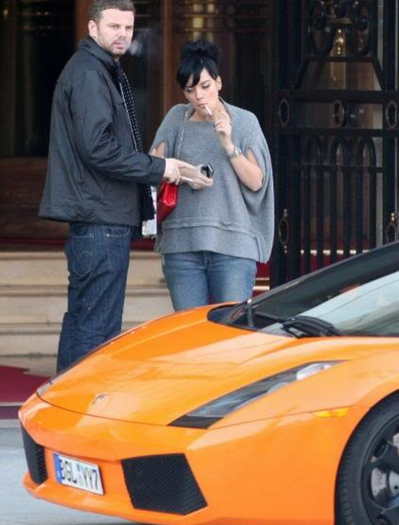 Lily owns an orange Lamborghini Gallardo priced at more than $200000.