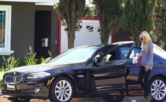 Actress Amanda Bynes drives around in a $95,000 black BMW X5