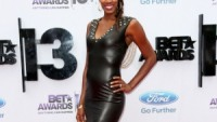 Dean Zign Faux Leather Deep V Bodycon Dress with Spike Studs and Draped Chain