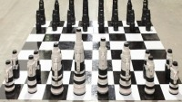 This camera lens chess set could be yours for $10,000 a week