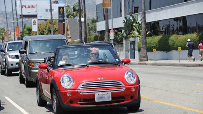 The singer has been frequently photographed with her electric red Mini Cooper Convertible.