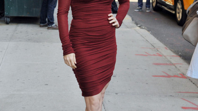 Finding Ms.Adams strolling outside the Ed Sullivan Theater was overwhelmed by the grandiose and chicness of the maroon-red twist dress from Helmut Lang.