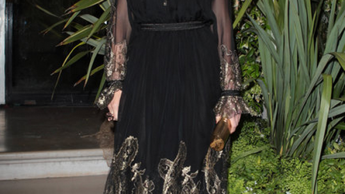 Swank flaunted her designer £1,000 Salvatore sandals to the Ferragamo Resort fashion show at the Louvre Museum in Paris.