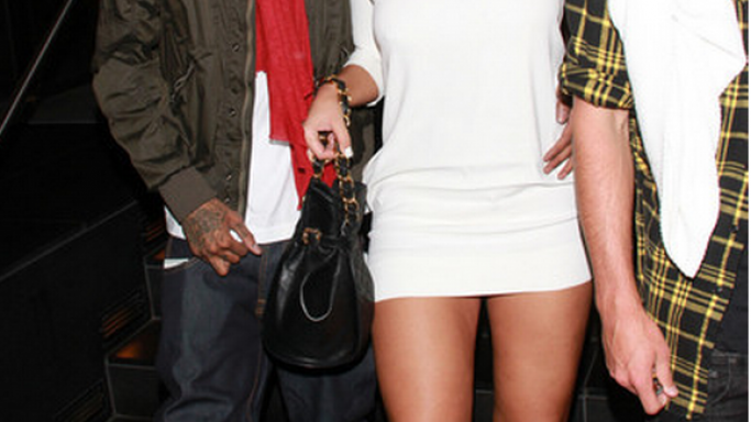 Wiz wears the Air Jordan 11 Retro Sneakers which has a black upper and a red Jumpman logo