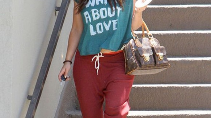 Jennifer Love Hewitt was spotted wearing the Chaser LA What About Love Tri-Blend Swing Muscle Tee on a day out in Los Angeles, California.