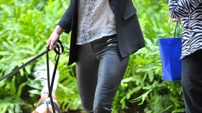 The actress was photographed wearing this designer pants while playing with her dog.