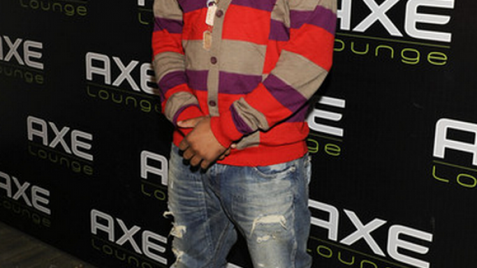 The artist was snapped wearing Marc Jacobs Striped Sweater cardigan to a high profile event.