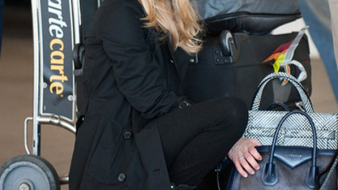 Ms. Seyfried carried her top-zip, leather duffle bag from Givenchy