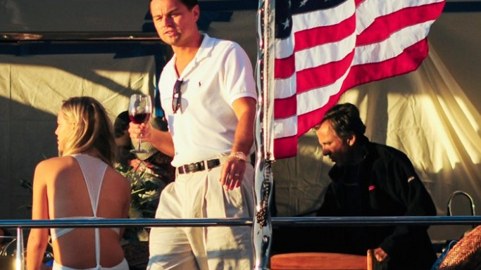 Leonardo DiCaprio wearing Polo Ralph Lauren on the set of The Wolf of Wall Street directed by Martin Scorsese