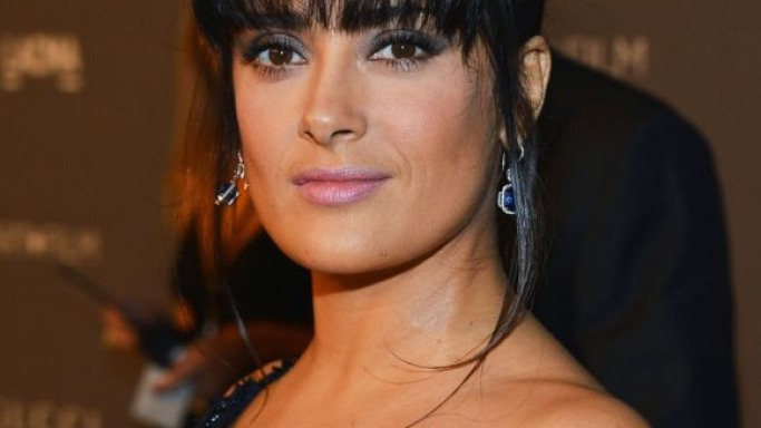 Salma Hayek-Pinault was spotted wearing million-dollar Harry Winston danglers set with micropave diamonds.