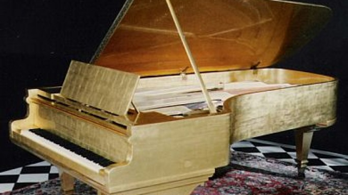 Elvis Presley's 24-carat Gold Piano to Go On Auction