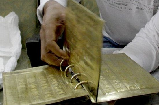 Historical 5 sheet gold-inlaid book