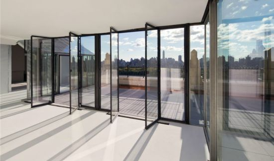 The penthouse has a 37-foot gallery with huge windows