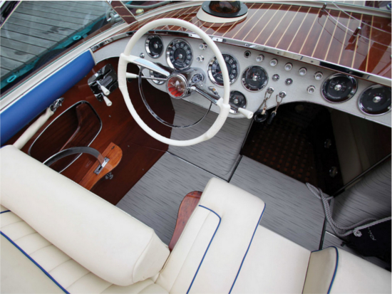 1960 Riva Tritone Special Cadillac Powerboat interior sees a lot of white, blue and red color fabrications
